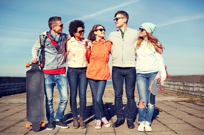 people, leisure and sport concept - group of happy teenage frien