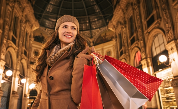 Happy Woman With Shopping Bags In Galleria Vittorio Emanuele Ii